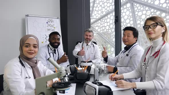 Thumbnail for Doctors Team Posing on Camera in Hospital Office and Showing Sign Ok