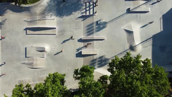 Skateboarders In The Evening At The Park