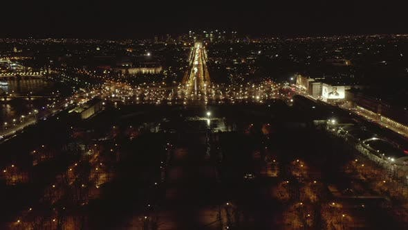 Cover Image for AERIAL: Reverse Drone Flight From Eiffel Tower,Tour Eiffel in Paris, France at Night with City