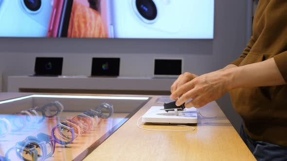 Thumbnail for Female Customer Choosing Smartwatch Shopping In Store.