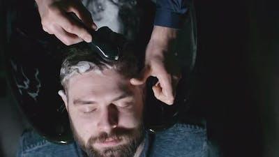 Washing Hair with Shampoo in Salon