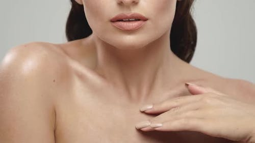 Closeup of Female Sensually Touching Her Shoulders