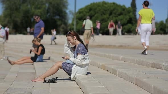 Thumbnail for Teenage Girl Relaxing at the Amphitheater of Belem in Portugal
