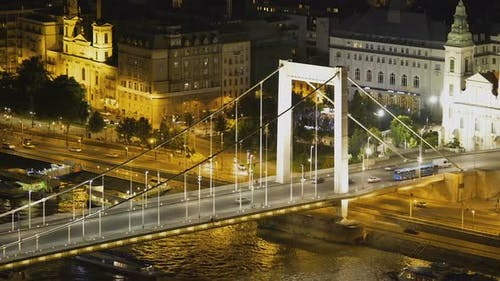 Beautiful Night View of Illuminated Chain Bridge and Road with Cars, Hungary