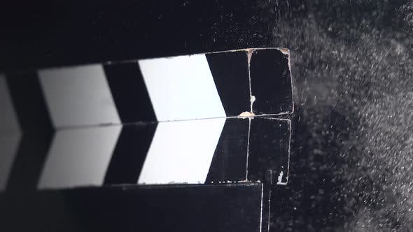 Movie Clapboard Action. Close Up. Black Background