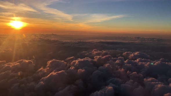 Thumbnail for Sunset above the clouds flying