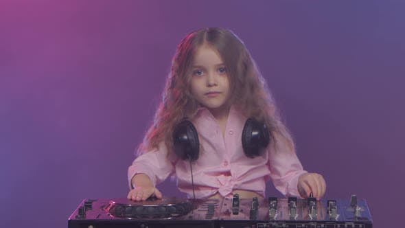 Thumbnail for Little Girl Dj Playing on Vinyl. Colored Smoke on Background
