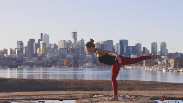 Thumbnail for Power Yoga Practice - Eagle Warrior 3 And Tree Stand By Strong Woman In City Landscape
