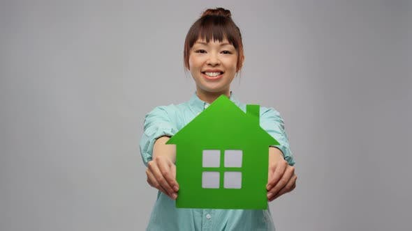 Smiling Asian Woman Holding Green House