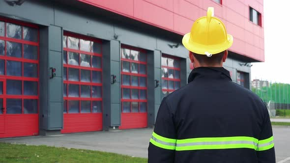 Thumbnail for A Firefighter (The Back To the Camera) Looks at a Fire Station