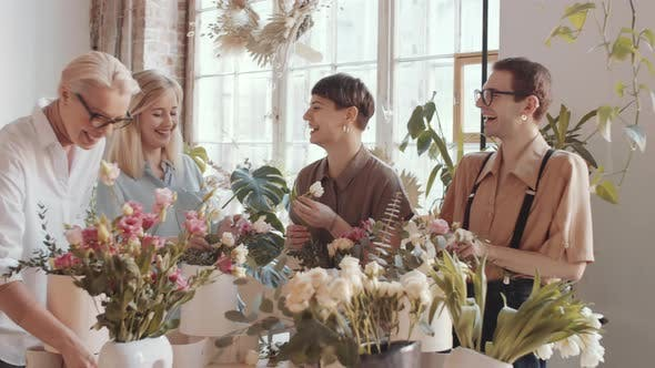 Thumbnail for Joyous Women and Men Chatting and Laughing on Floristics Masterclass