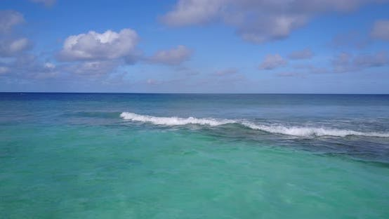 Thumbnail for Tropical fly over copy space shot of a sandy white paradise beach and turquoise sea background in hi