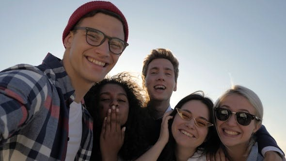 Thumbnail for Group of happy multiethnic teenagers taking a selfie.