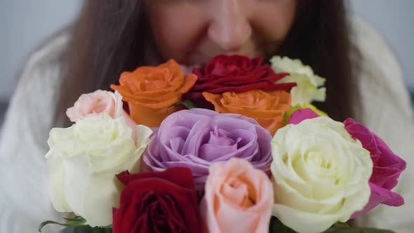 Thumbnail for Close Up Face Woman Sniffing Colorful Roses in Bouquet