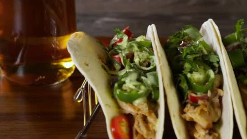 Chicken Tacos and Beer on Wood Board