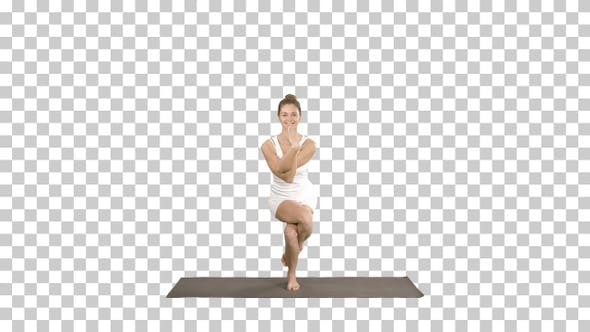 Cover Image for Attractive Girl Standing in The Balancing Yoga Pose Garudasana