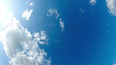 Clouds Move Smoothly in the Blue Sky with Fisheye Effect. Timelapse