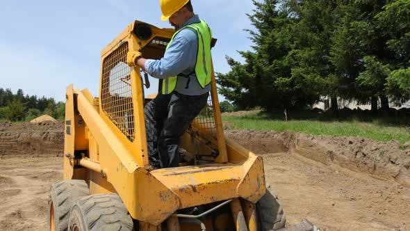 Thumbnail for Worker driving excavator