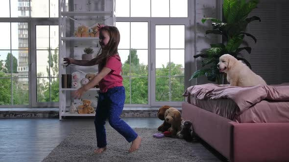 Thumbnail for Graceful Child Dancing for Puppy Sitting on Bed