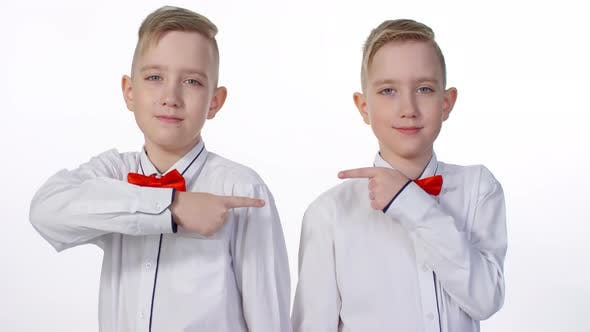 Thumbnail for Blond Identical Twins Posing in Studio for Family Album