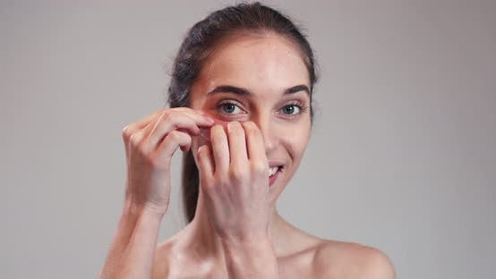 Thumbnail for Woman Putting Collagen Pads Under Her Eyes