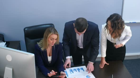 Thumbnail for Business Team Discussing Documents in Office
