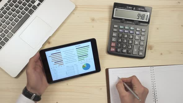 Thumbnail for Using tablet and hand calculator