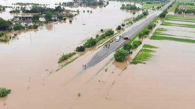 Flooded Highway. Flooded Road During Floods. Cars That Can Not Pass on the Road Flooded River.