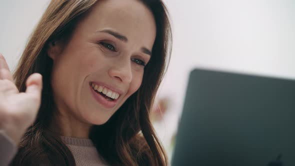 Thumbnail for Brunette Woman Waving Hand To Laptop Screen