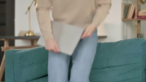 Thumbnail for Young Woman with Laptop Coming Back, Sitting on Sofa