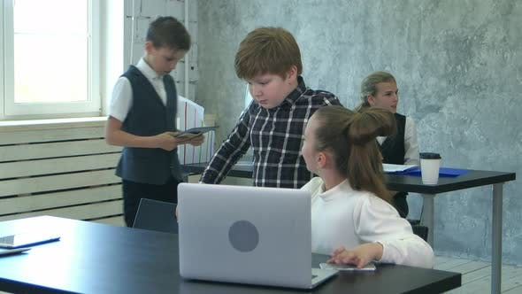 Thumbnail for Little Office Kids Working with Documents and Laptop Computer in Office