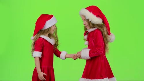 Baby Girls in Red Suits Play Games, Smile and Have Fun, Green Screen
