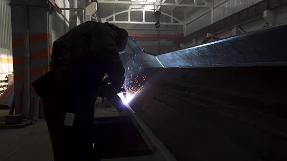 Thumbnail for Manual Metal Welding, Spark Flow on Dark Background. Industrial Production. Protective Masked Welder