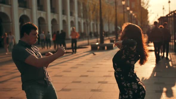 Thumbnail for Young Couple Dancing on City Big Road and Sunset Sun in Background.