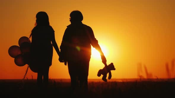 Thumbnail for Grandmother and Granddaughter Admire the Sunset Together