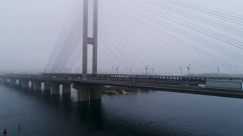 Aerial View of South Subway Cable Bridge in the Fog