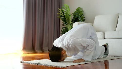 Portrait of an Asian Muslim Man Prostrating