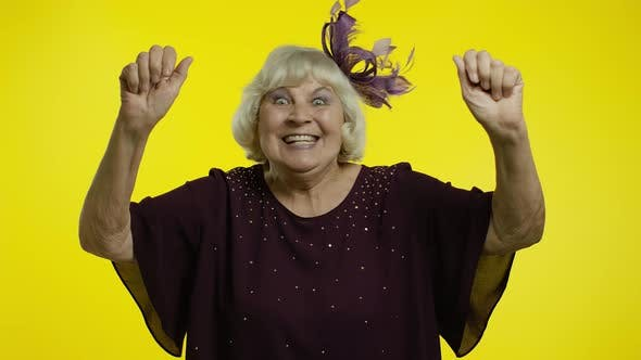 Thumbnail for Extremely Happy Satisfied Senior Old Woman with Blond Hair Celebrating Victory with Smile, Success