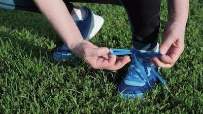 Hands tying shoe laces