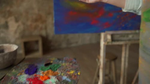 Woman Artist Brush Mix Color Oil Painting on Palette and She Paints a Picture