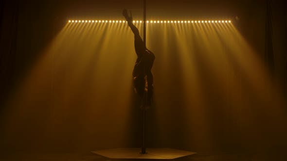 Thumbnail for Athletic Sexy Young Girl Spins on a Pole Upside Down and Does an Acrobatic Trick, Slim Attractive