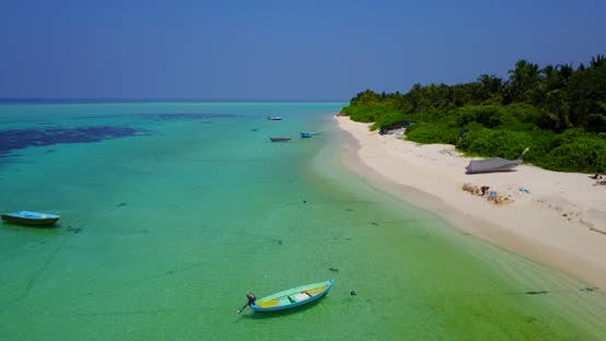 Thumbnail for Daytime fly over island view of a summer white paradise sand beach and turquoise sea background in c