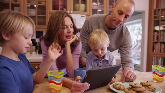 Thumbnail for Happy young family enjoying a tablet computer for the holiday