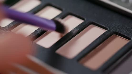 Thumbnail for Palette with eye shadows and a makeup brush