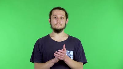 Displeased Man Claps His Hands