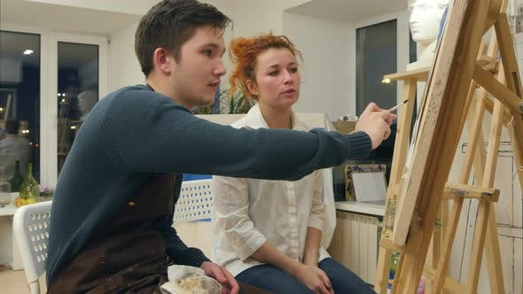 Cover Image for Female Artist Teaching Young Student To Paint with Watercolor