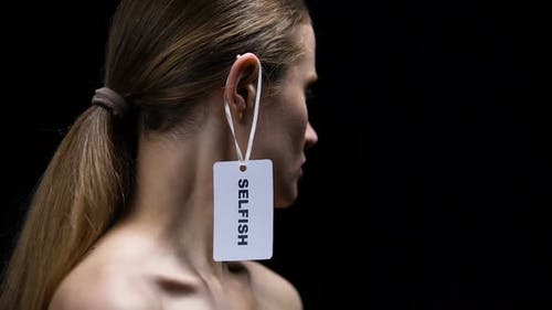 Woman Taking Off Selfish Tag From Ear, Self-Confidence, Protest Against Affront