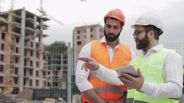 Thumbnail for The Builder and Architect Man Are Discussing the Construction Plan of the Modern Business Center