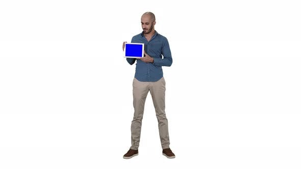 Thumbnail for Smiling Casual Man Presenting a Tablet with a Blank Screen on White Background.