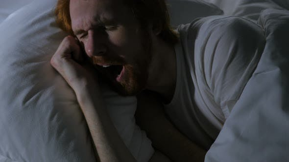 Thumbnail for Beard Man Yawning while Lying in Bed